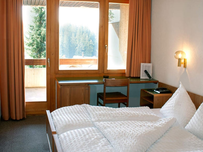 Classic double room interior with door to balcony